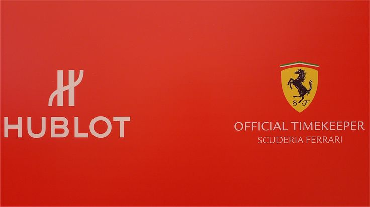 "HUBLOT + FERRARI.  Hublot is the Watch and Timekeeper of Ferrari"", as well as the ""Timekeeper of Scuderia Ferrari."