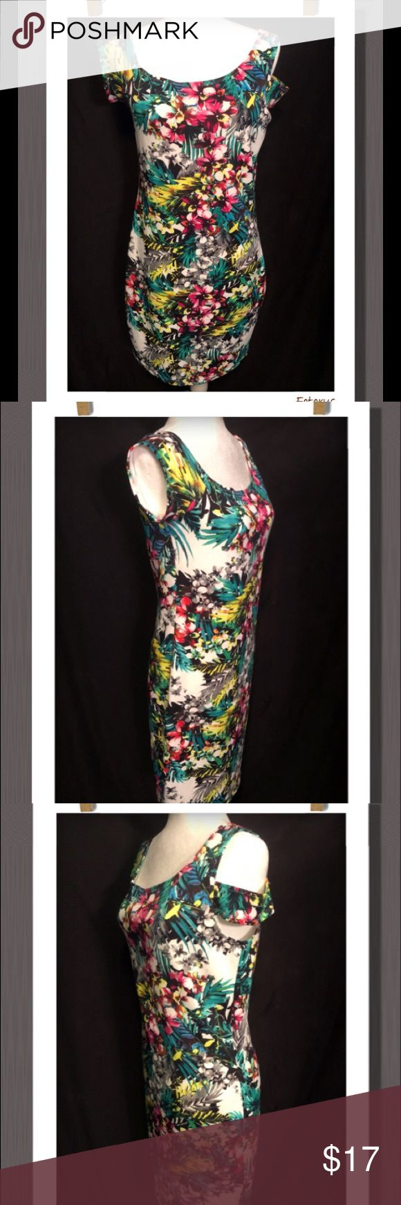 🌹Nicky Minaj Floral Dress🌹 Multi-Color Floral stretch dress with one side cold shoulder (super cute) Gold zipper back closure, really light&soft. Measures in length approx. 35-1/2in. Bust Aprox. 18in across measurements taken unstretched. Would definitely compliment your shape. 95% Polyester  5% Spandex Nicky Manaj Dresses Midi