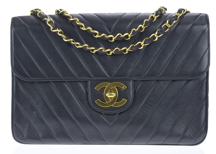 Chanel Vintage Black Chevron Maxi Lambskin Flap Bag puts a chic twist on the classic flap! The chevron detail with gold tone hardware pull this whole bag together. Featured in black lambskin leather w