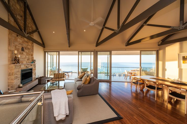 Traditional wood fireplace, stone clad, exposed rafters, in beachside location