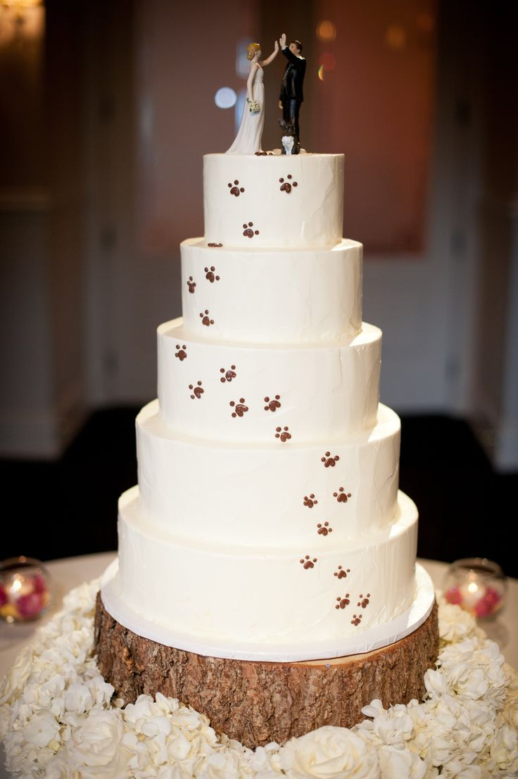 LOVE this Pawprint Covered Wedding Cake with the adorable Dog Figurine on the top with the bride and groom (see http://www.weddingfavorsunlimited.com/miniature_dog_figurine_cake_toppers_5_designs.html and http://www.weddingfavorsunlimited.com/high_five_bride_and_groom_figurines.html to buy the figurines).