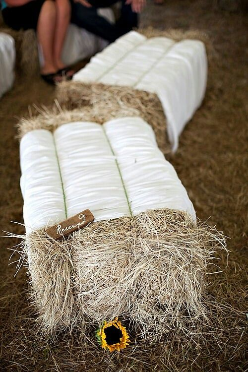 Hay bale seating at a rustic barn wedding. #RusticWedding #WeddingCeremony