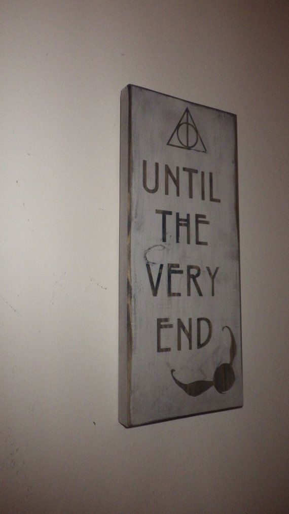 This beautifully aged plank of wood bears the quote: Until the very end with the Deathly Hallows icon and a snitch. A great wall hanging for