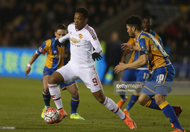 Anthony Martial of Manchester United in action with Nathaniel Knight-Percival of Shrewsbury Town during the Emirates FA Cup Fifth Round match between Shrewsbury Town and Manchester United at Greenhous Meadow on February 22, 2016 in Shrewsbury, England.