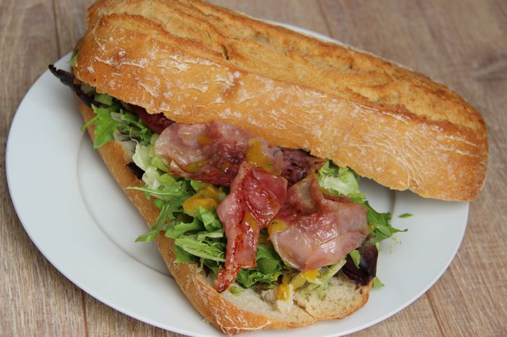 Bread (ciabatta) with lettuce, baked ham and honey-mustard sauce - Ciabatta broodje met sla, warme ham en honing-mosterdsaus