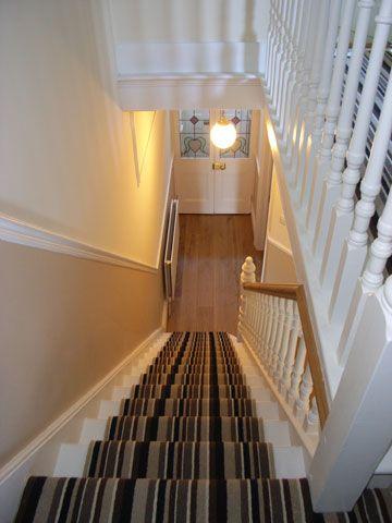 designer striped stair carpet provides contemporary interior to victorian house
