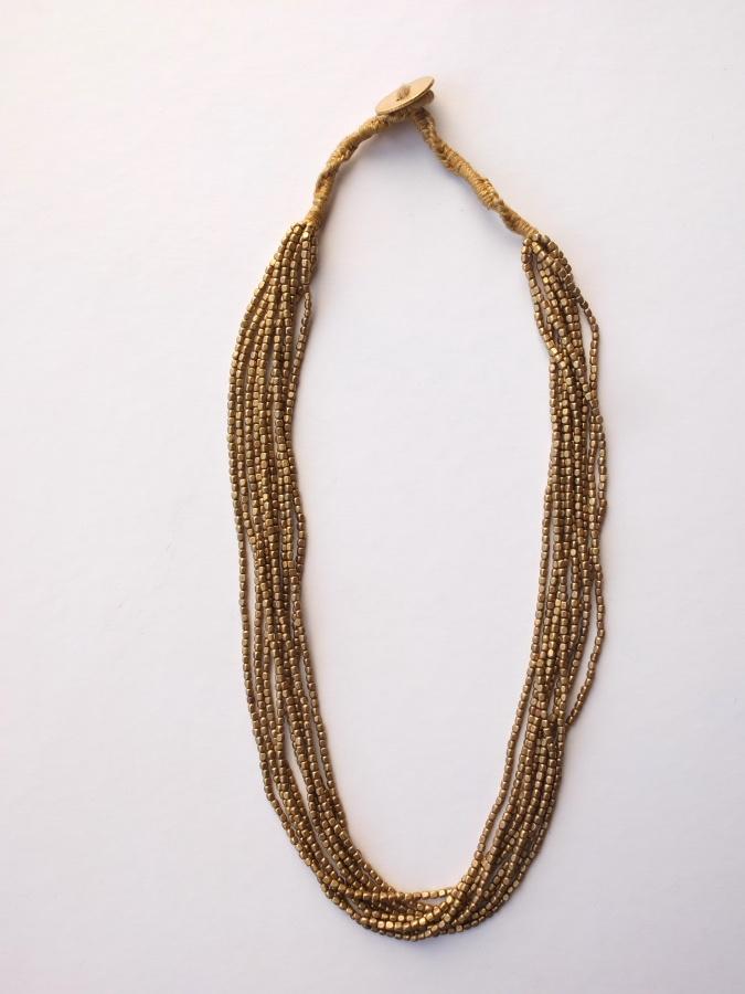 Short necklace made of golden fine brass.