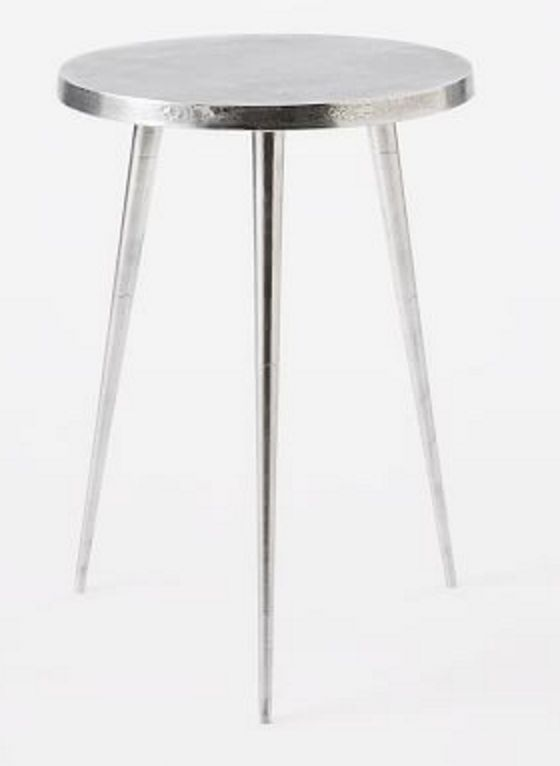 Shiny silver three-legged side table