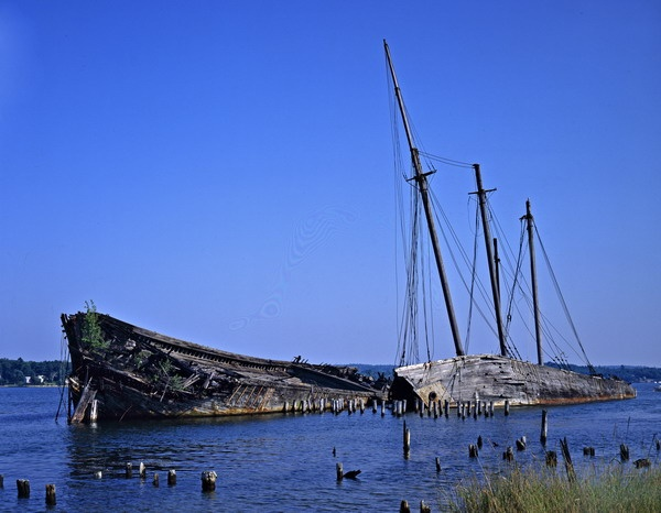 """Old Schooners in Wiscasset, Maine --oooh how I hate that they've been destroyed by fire! Ever since I was a baby I always loved going over the bridge at Wiscasset and seeing my """"ghost ships"""". Now they truly are ghosts."""