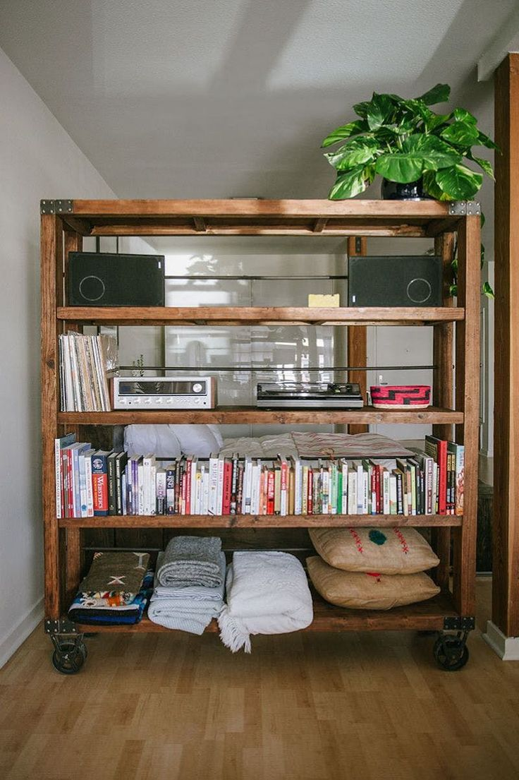 If you're committed to separating your space, you may as well take a lesson from this California studio on The Everygirl and make your divider work for you. Buying or building a wheeled divider with shelves will give you an extra storage area for pillows, books or your record player. The best part: You don't need to feel bad about your collecting habit, because the more you stock the shelves, the more privacy you'll gain.