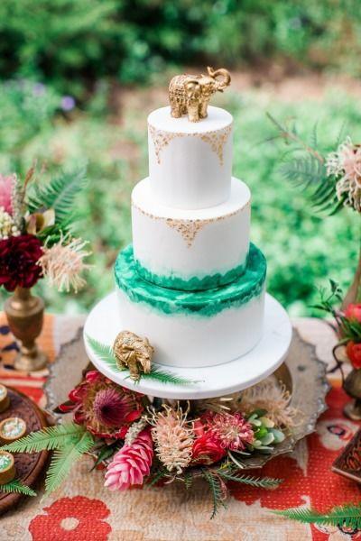 Destination inspired cake: http://www.stylemepretty.com/california-weddings/2015/06/06/colorful-boho-wedding-inspiration-for-the-world-traveler/   Photography: Elisabeth Arin - http://elisabetharin.com/ #wedding #cake #cupcake #caketopper