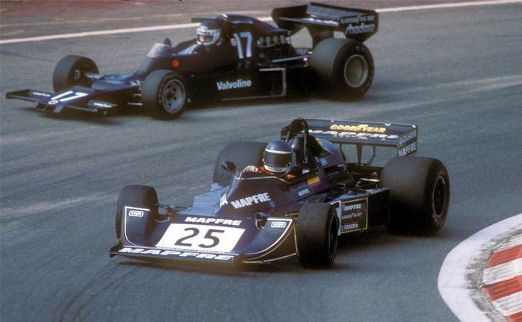Slow Emilio Zapico (Williams FW04) closes door front of Jean-Pierre Jarier (Shadow DN5B) at the 1976 Spanish GP qualifying race