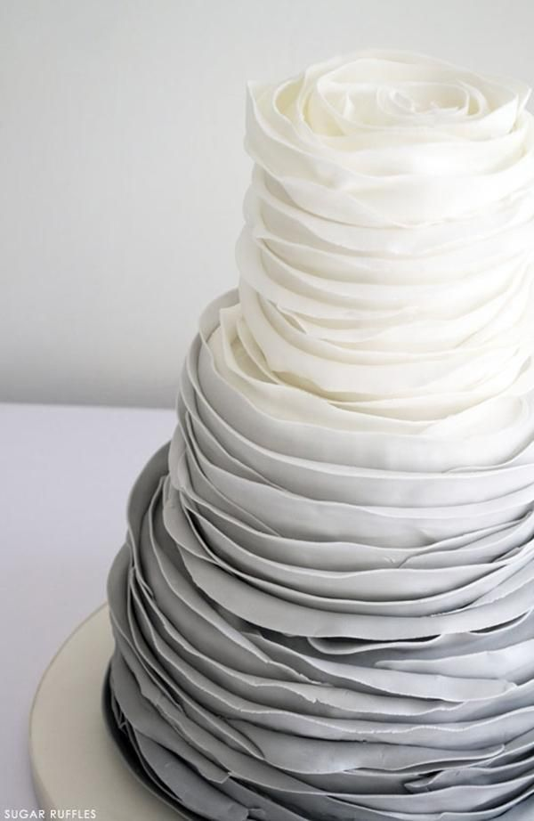 If you are completely over the white buttercream wedding cake, we hear you. Spice up your three tiers with full-on ruffles like this gray and white ombre cake.