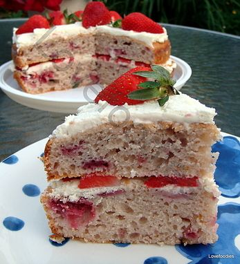 Strawberry Invasion Cake - This cake is light, fluffy and BURSTING with strawberry flavour! Check out the strawberry invasion!