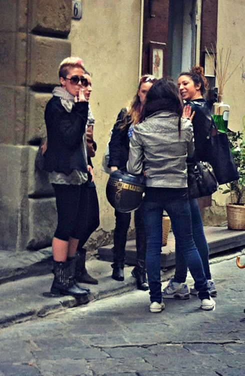 Leather and motorcycle boots-street fashion in Florence, Italy