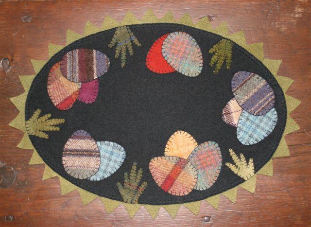 cute wool mat... love the plaid easter eggs!