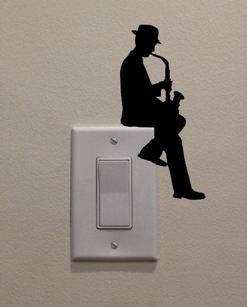 Man Playing Saxophone On Light Switch 6.5x3.2 by DecalPhanatics