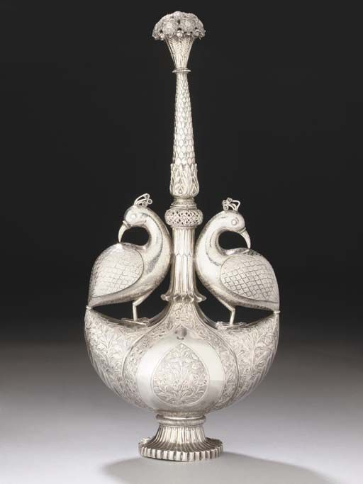 AN INDIAN CAST AND CHASED SILVER ROSEWATER SPRINKLER   NORTH INDIA, SECOND HALF 18TH CENTURY