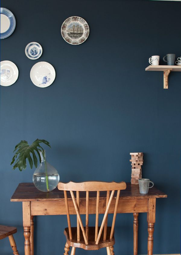 Dark blue walls - great contrast against wood elements