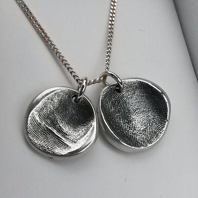 Natural shaped fingerprint pendants.