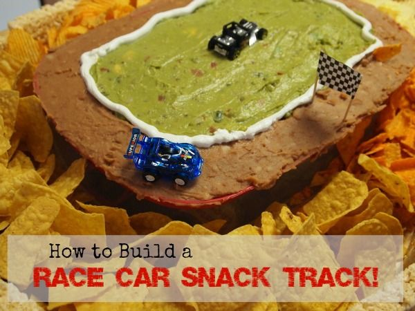 Fun food for a race car party - perfect for kid's birthday parties, or Nascar viewing for adults :) Love the @Wholly Guacamole as the grass!