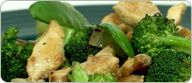Broccoli Ginger Chicken; 3 Block Meal; Ingredients: 1 teaspoon olive oil 3 ounces boneless, skinless chicken breast, cut into strips 2 cups broccoli florets, washed 1 1/2 cups snow peas, washed 3/4 cup yellow onion, peeled and chopped 1 teaspoon fresh ginger grated 1/4 cup water 1/2 cup seedless grapes