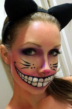 Cheshire cat inspired Halloween makeup. Use your artistic skills and draw the charming Cheshire smile across your face over the lips to create the illusion of a wide cat grin.