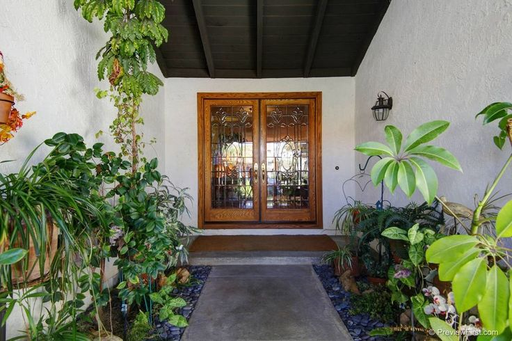 Tropical Front Door with Borano Custom Door, exterior stone floors, French doors