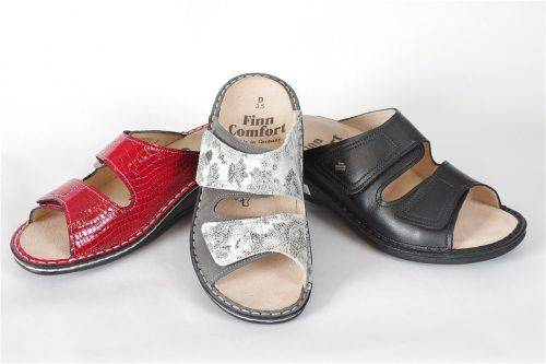 JAMAIKA by Finn Comfort: Wide fit double velcro slide with removable footbed  firm insoles.  Outstanding support for all day comfort. Ideal slipper for those needing more support.  Adjustable enough to fit extra wide widths.  Orthotic friendly