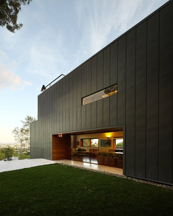 Wrapped in zinc cladding and rising up three levels, the modern Rosalie Residence takes advantage of a hillside location in Brisbane, Queensland, Australia. The environmental friendly home was envisioned by Richard Kirk Architects and boasts a total of five bedrooms- more than enough space for a family haven.