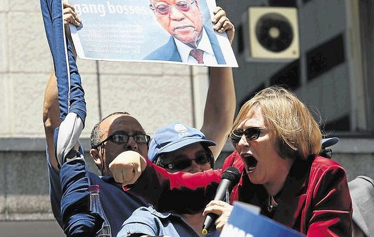"""Top News: """"SOUTH AFRICA: 'Zuma Loves Gangsters' - Democratic Alliance"""" - http://www.politicoscope.com/wp-content/uploads/2015/12/Western-Cape-Premier-Helen-Zille-speaks-to-supporters-outside-the-ANC-offices-in-the-Cape-Town-CBD-where-DA-protested-over-meeting-between-Jacob-Zuma-and-Cape-gang-leaders.jpg - Democratic Alliance protests African National Congress (ANC)  """"cosy relationship"""" with gangsters in the province.  on Politicoscope - http://www.politicoscope.com/south-"""