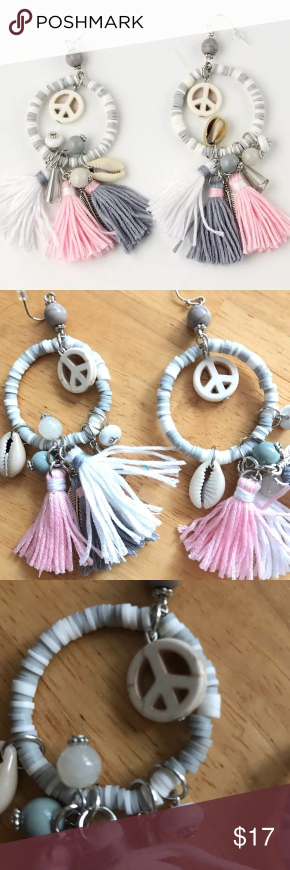 Bohemian Style Tassel Earrings Bohemian Style White pink Tassel Earrings   Beautiful details with sea shell, peace sign pink gray white tassels, earrings are not to heavy so pretty😍 Material : Alloy Chain +resin Size: the length is about 19.7''  bib statement Wide:1.58''  stretch chain:3.16''. NWOT    🛍BUNDLE & SAVE 15%🛍 ✨TOP RATED SELLER✨ 📦SAME DAY OR NEXT DAY SHIPPING!📦 ❤REASONABLE OFFERS WELCOME❤ ❌NO TRADES OR PAYPAL❌ Jewelry Earrings