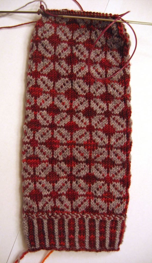 "https://flic.kr/p/5VtUK2 | Dad's First Mitten | Kalev's Mittens from Folk Knitting in Estonia. Yarn: Red - STR lightweight in Mustang Sally, Gray - Tess Supersock & Baby. I should be able to finish it up today at lunchtime. The decreases are a bit unusual (""wick"" decreases) but create a nice flat line. I really like the gray and red together!"