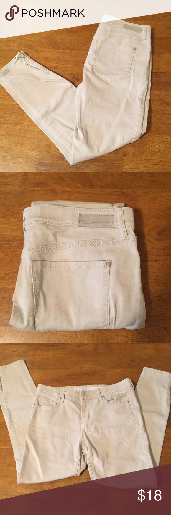 """DKNY Jeans City Skinny Zipped Ankle Off White This adaptable pair of DKNY skinny jeans is in like new condition, and looks fantastic with various outfits. It's suggested for either semi formal or casual wear. While maintaining a bit of stretch, these pants are mostly stiff and form fitting.   Material: 98% cotton, 2% spandex  Measurements: Rise: 9"""", Waist: 30"""" circumference, Inseam: 27"""".  Take 50% off these pants and 10% off entire order when bundled with additional items in my closet. Dkny…"""