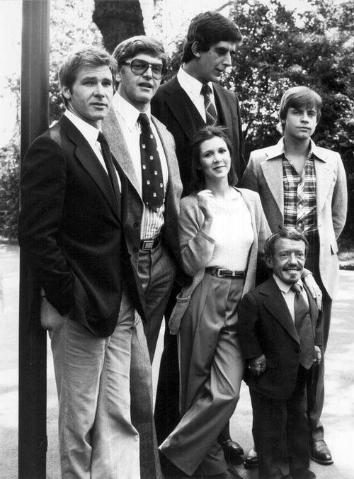 starwars cast, left to right: Harrison Ford (Han Solo), David Prowse (Darth Vader), Peter Mayhew (Chewbacca), Carrie Fisher (Princess Leia), Kenny Baker (R2-D2), and Mark Hamill (Luke Skywalker).