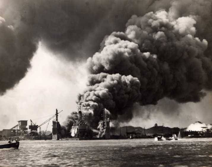 Floating Drydock YFD-2 with destroyer Shaw and heavy smoke following the explosion in Shaw's forward magazine, Pearl Harbor, Oahu, Hawaii, Dec 7, 1941.
