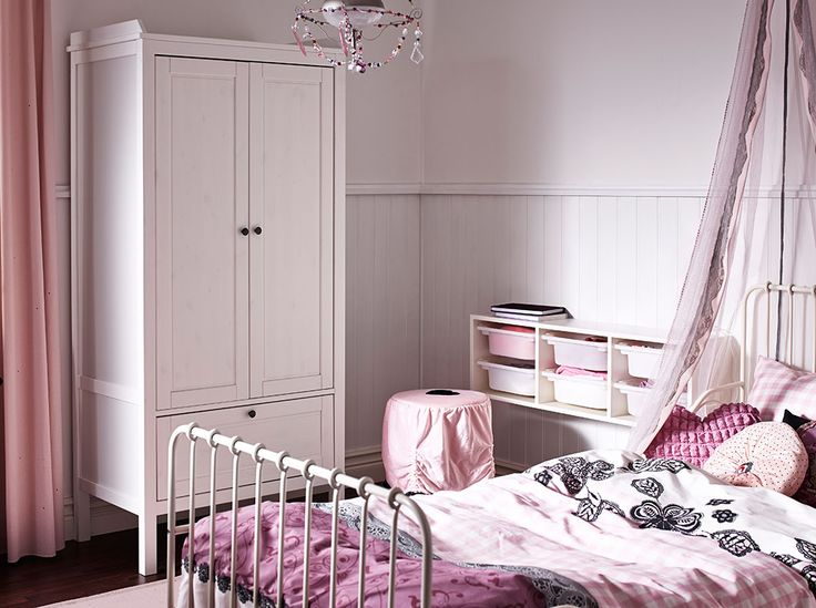 I love the look of this room for a simple teen set up - <3 - A white wardrobe with an white extendable children's bed