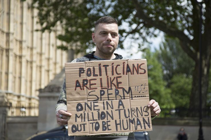Protester with his placard outside the Houses of Parliament (Picture: Getty)