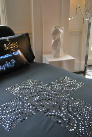The embellishment on this stunning bed linen creates a fantastic, tactile sleeping area.