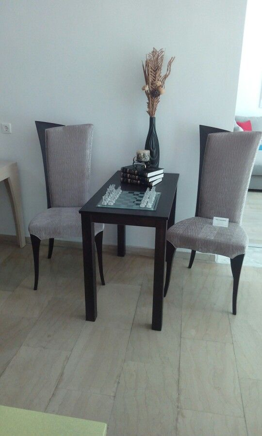 A simple minimal style table and two modern-classic chairs can take the role of the statement pieces in our lounge