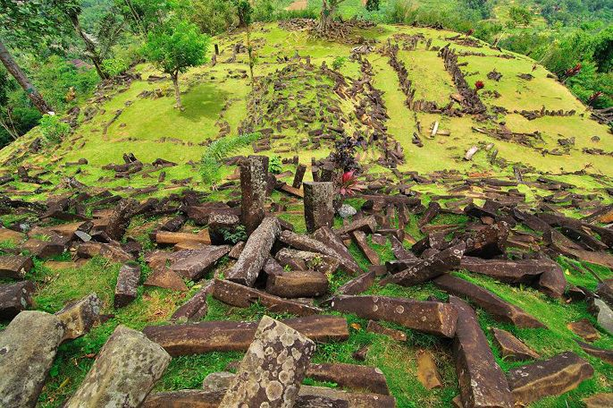 """""""What Natawidjaja (the Indonesian archeologist) discovered at Gunung Padang was astounding. The hill was actually not a natural hill but a 300-ft high step-pyramid."""" Drill cores found layers of of construction that continued deeper, suggesting much of the mountain may be man-made or shaped, with dates of 20,000 BC and older!"""