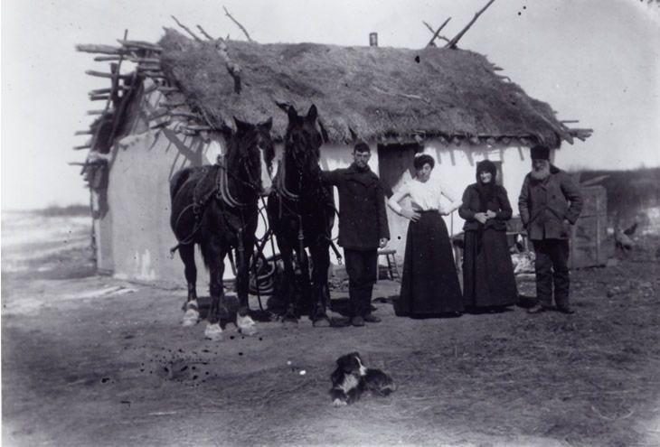 Ukrainian immigrant family in front of their house. 1903-1907 Lipton, Saskatchewan, Canada