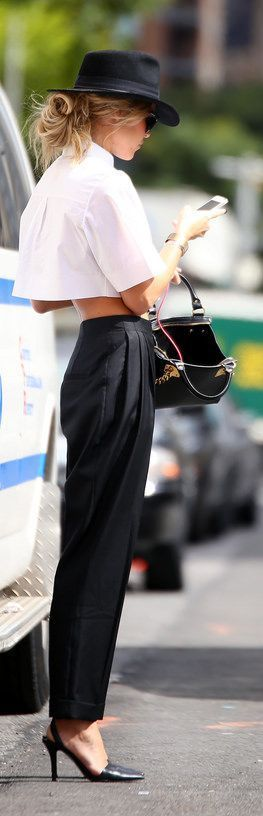 Super chic black & white outfit! High waisted trousers and a cropped white shirt.