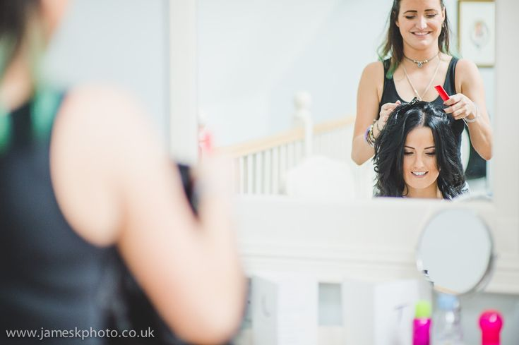 Wedding at Woburn Abbey, Bedfordshire. Bride and bridesmaids getting ready. Wedding hair. www.jameskphoto.co.uk