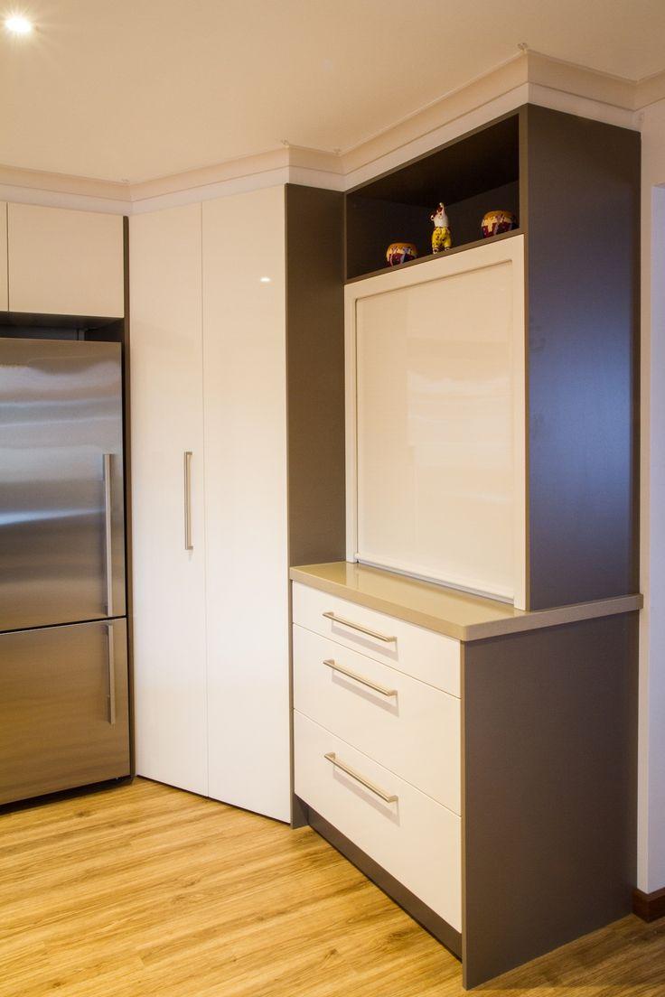 Corner pantry. Appliance pantry. Roller door. Contemporary kitchen. www.thekitchendesigncentre.com.au