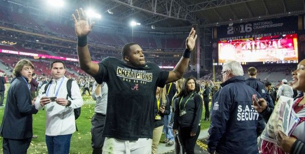 Alabama linebacker Reggie Ragland (19) cheers the fans as Alabama celebrates after their 45-40 victory over Clemson in the College Football Playoff National Championship football game, Monday, Jan. 11, 2016, at University of Phoenix Stadium in Glendale, Ariz.