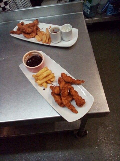 Homemade chicken goujons with homemade chips and a homemade barbeque dip