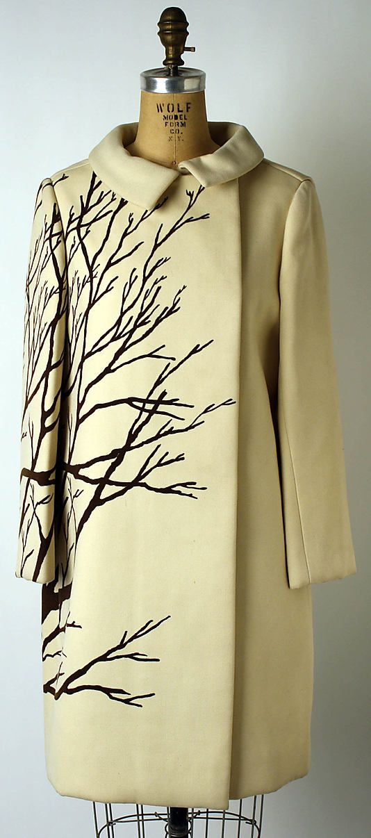 this cream colored wool coat is a work of art with tree branches stretching across one side, ca 1967, by Bill Blass