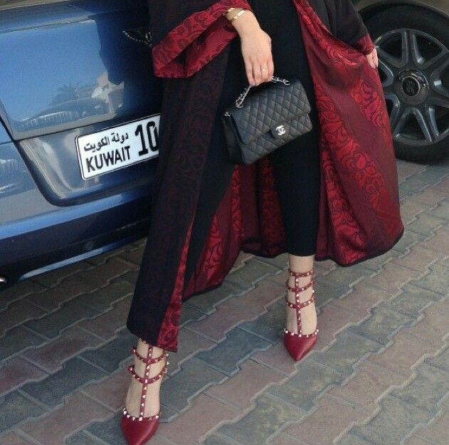 Beautiful red abaya, Chanel handbag and Valentino heels
