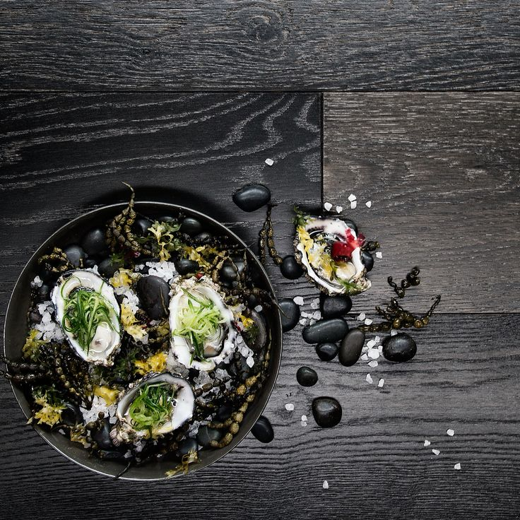Sydney rock oysters with wild seaweed, pickled cucumber and gin and tonic foam.
